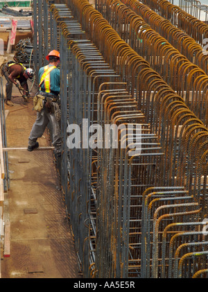 two steel workers installing steel rebar in new construction on the waterfront in vancouver canada rebar worker