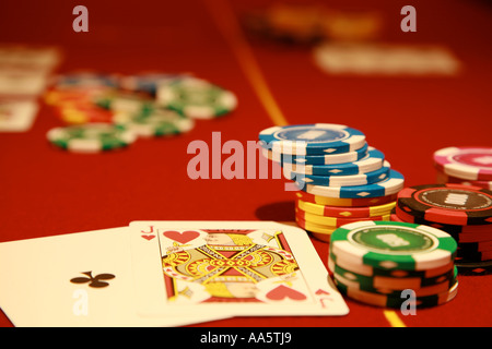 Poker chips in a casino - Stock Photo