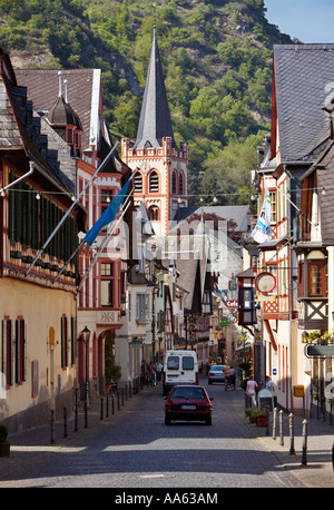 Bacharach in the Rhine Valley church of St Peter and old street with half timbered houses Germany Europe - Stock Photo