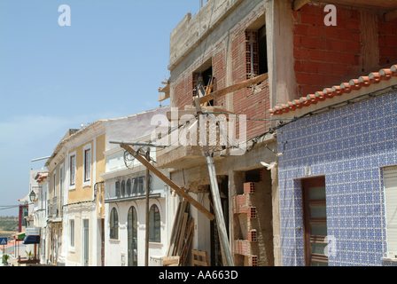 Building Work Being Undertaken on Restaurant Premises in Alvor Town Algarve Portugal - Stock Photo