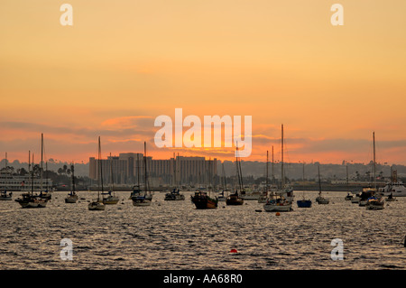 Sailboats moored in the harbor at sunset San Diego California - Stock Photo