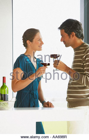 Man and woman drinking wine - Stock Photo