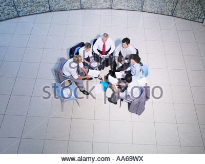 Aerial view of a group of office workers meeting in a rotunda - Stock Photo