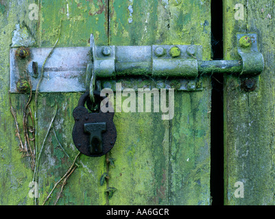 Rusty padlock on an old shed door in the corner of a feld in Somerset - Stock Photo