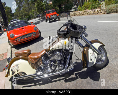 Americana ; Harley Davidson parked on Ocean Avenue with Ford Thunderbird and Jeep behind Carmel  Monterey County - Stock Photo