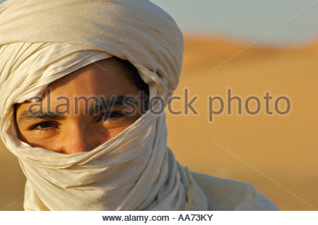 Tuareg Berber Boy Saharan Desert Merzouga Morocco North Africa - Stock Photo