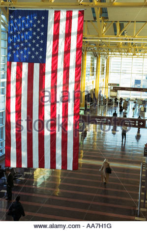American flag hanging in airport, Reagan International Airport - Stock Photo