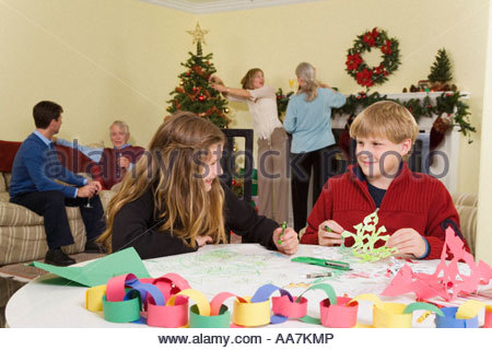 Teenagers making Christmas snowflakes - Stock Photo