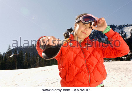 Female skier carrying skis - Stock Photo