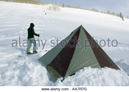 Skier pitching tent - Stock Photo