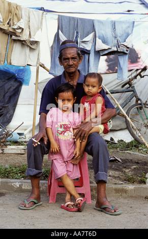 Grandfather and grandchildren survivors of the 26th Dec 04 tsunami Banda Aceh - Stock Photo