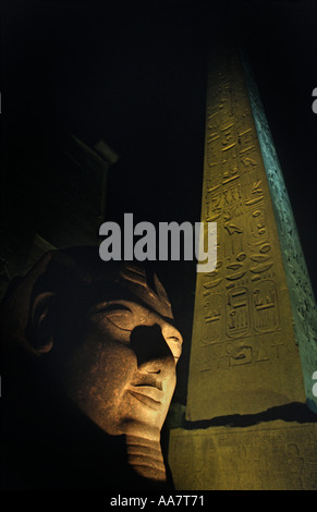 Luxor Temple at night Egyptial antiquities Luxor Egypt Ramses II s collosal head and obelisk - Stock Photo