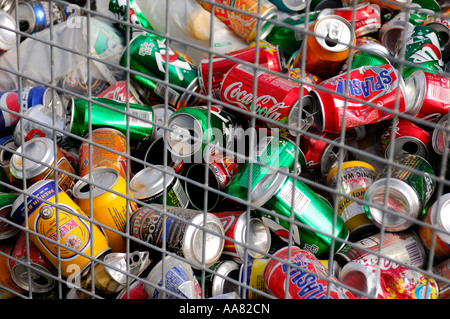 Aluminium soda cans in a container for recycling - Stock Photo