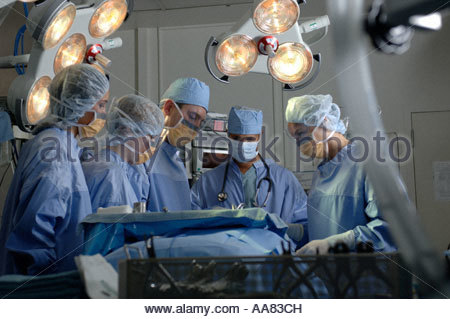 Surgeons operating on patient - Stock Photo