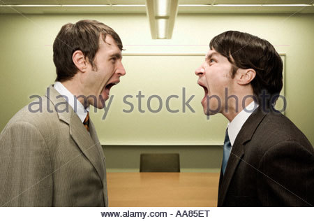 Businessmen shouting at each other - Stock Photo