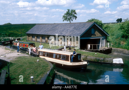 Narrowboats at Bulbourne lock and dry dock on the Grand Union Canal in Buckinghamshire England UK - Stock Photo