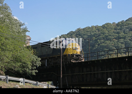 Train exits tunnel on Maryland side of Potomac River. - Stock Photo