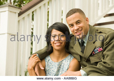 African military soldier hugging wife - Stock Photo