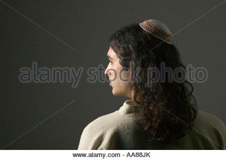 Young man wearing yarmulke - Stock Photo