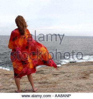 Woman in sarong on beach - Stock Photo