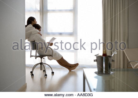 Couple relaxing in hotel room, Buenos Aires, Argentina - Stock Photo