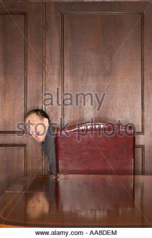 Asian man laughing over shoulder - Stock Photo