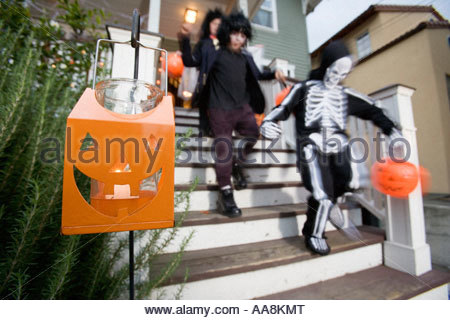 Young children trick or treating on Halloween - Stock Photo