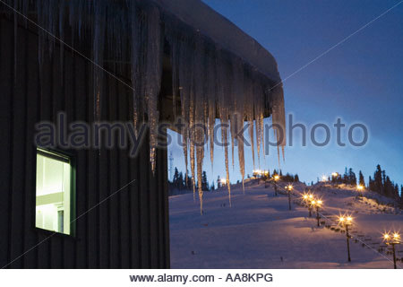 Icicles hanging from roof - Stock Photo