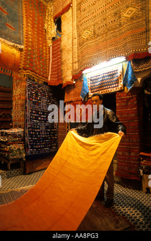 Man Selling Carpets Medina of Fes Morocco - Stock Photo