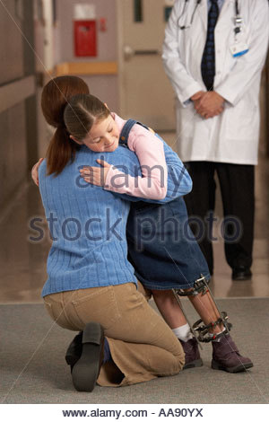 Mother greeting her daughter in hospital - Stock Photo