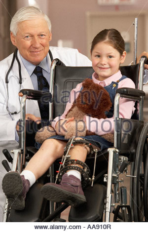 Girl wearing leg brace in wheelchair - Stock Photo