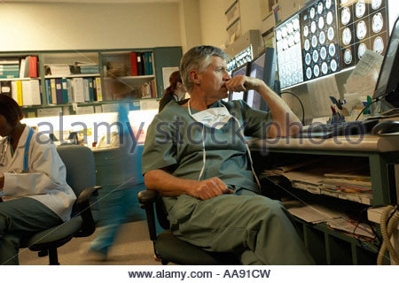 Male doctor looking at x-rays - Stock Photo