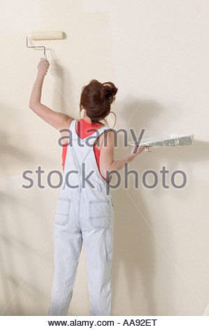 Woman painting wall - Stock Photo