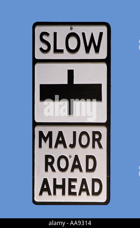 Vintage UK traffic sign for slow major road ahead - Stock Photo