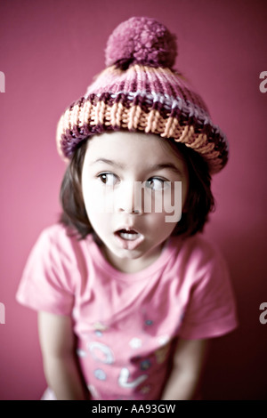 Girl in pink with bobble hat - Stock Photo