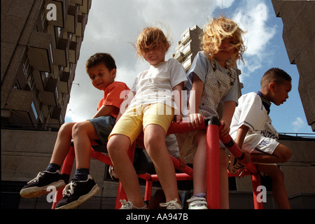 Young children playing at open-air nursery on housing estate in London. - Stock Photo