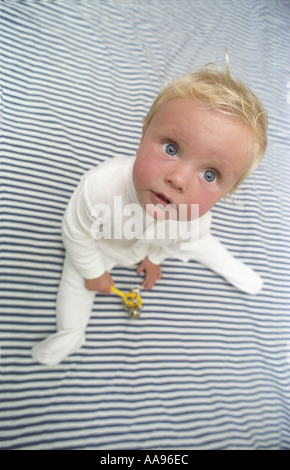 Baby on a striped blanket - Stock Photo
