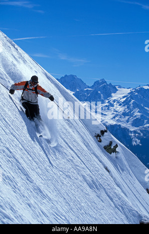 Extreme skier off piste coming fast down an almost vertical slope high in the mountains of the Chamonix area of - Stock Photo