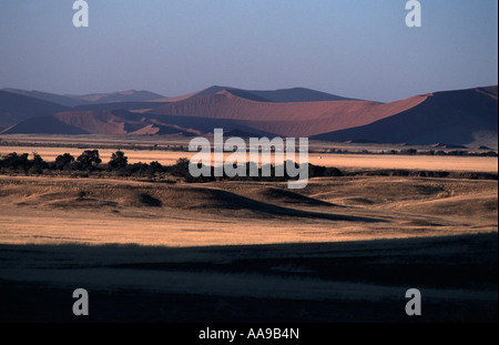 Sand dunes and surrounding landscape at sunrise Namib Naukluft National Park en route to Dune 45 and Sossusvlei - Stock Photo