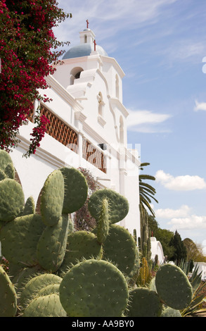 Prickly pear cacti growing in front of Mission San Luis Rey de Francia, Oceanside, California, USA - Stock Photo