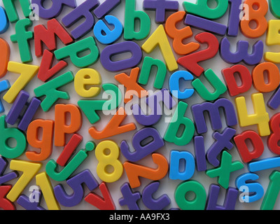 Magnetic letters and numbers on a fridge. - Stock Photo