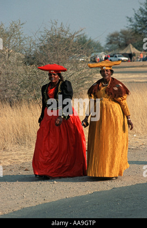 Two Herero women wearing traditional dress in at the Ma Herero Day Parade August Okahandja Namibia - Stock Photo
