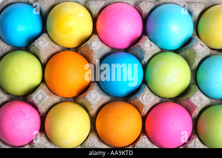 Colorful easter eggs in egg carton. - Stock Photo