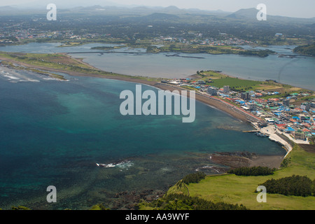 Village of Seongsan at the foot of Ilchulbong a volcanic cone Jeju island South Korea East Sea (Sea of Japan) - Stock Photo