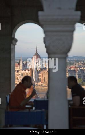 Hungarian Parliament building seen through the Fishermen Bastion Budapest - Stock Photo