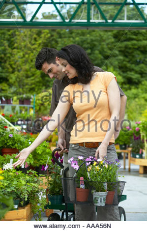 Couple shopping at plant nursery - Stock Photo