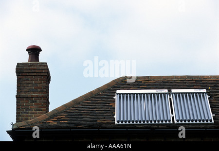 Solar thermal evacuated vacuum tubes supplying hot water to a residential propery in Braintree, Essex, UK. - Stock Photo