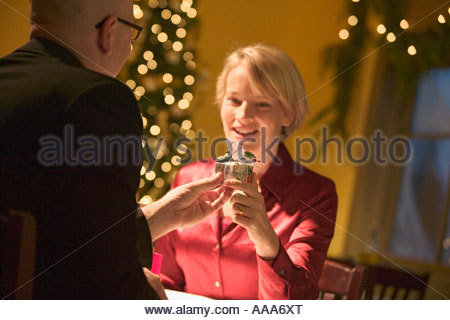 Man giving woman a gift - Stock Photo