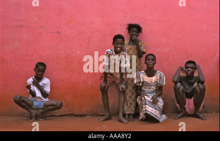 Group of children against pink wall in Accra, Ghana - Stock Photo