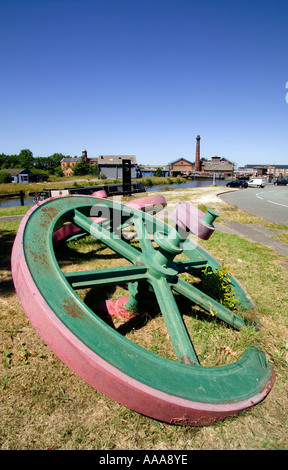 'Cast Iron' Pulley Fly Wheels displayed on the Canalside at 'Ellesmere Port',Cheshire,England,UK,GB. - Stock Photo